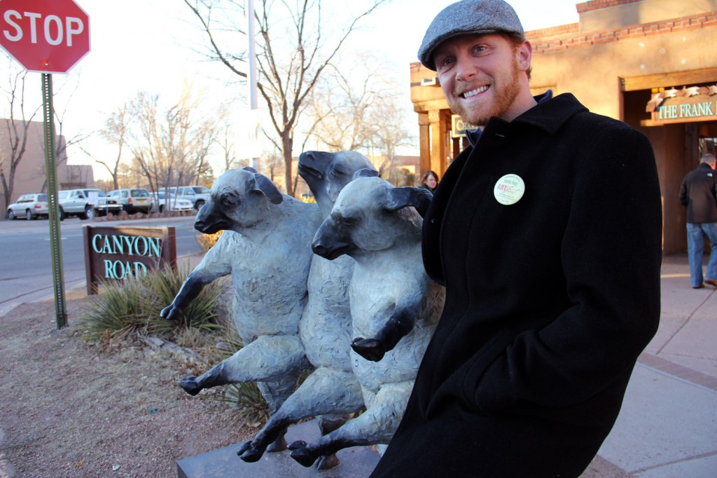 Cory kicking it with three sheep on the street!